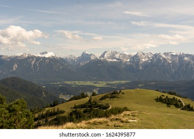 Panoramic photo with a view from the mountain Wank in Bavaria with a view of the Karwendel mountain range with snow in the autumn
