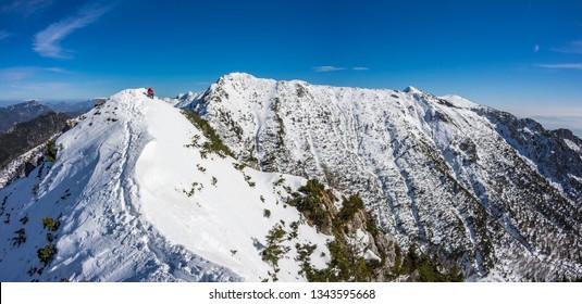 Panoramic photo of the winter mountain ridge with Baseljski vrh and Mali Grintovec in Kamnik-Savinja Alps