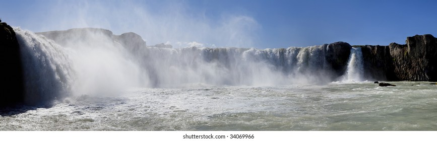 Panoramic photograph of Godafoss waterfall in Iceland, taken at water level.