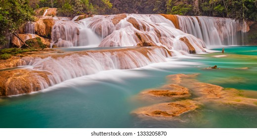 Panoramic photograph and long exposure of the Agua Azul cascades and waterfalls in the tropical rainforest of Chiapas state near the city of Palenque, Mexico.
