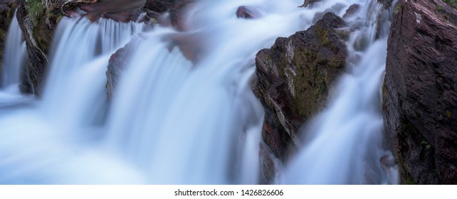 Panoramic photograph of Red Rocks Falls in Glacier National Park, Montana.