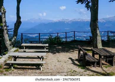 Panoramic picnic spot with wooden tabels and benches halfway up to Monte Generoso along souther Lake Lugano (canton of Ticino, Switzerland).