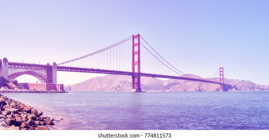 Panoramic picture of the Golden Gate Bridge at sunset, color toned image, San Francisco, USA.