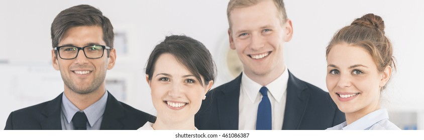 Panoramic picture of a group of smiling workers