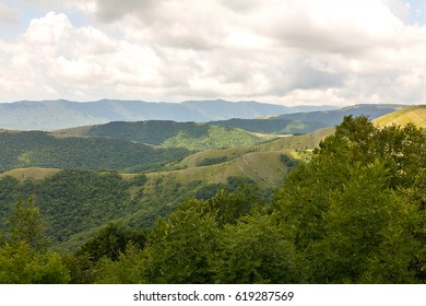 Panoramic picture of the mountains covered with greens on a cloudy sky background a pleasant walk in the silence of nature