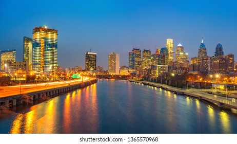 Panoramic picture of Philadelphia skyline and Schuylkill river at night, PA, USA.