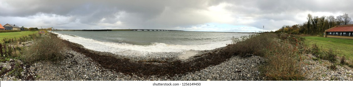 Panoramic picture taken of the oresund bridge in Denmark, connecting Jutland with Odense. Stormy weather with open sky.