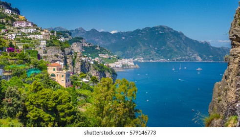 Panoramic picture-postcard view of the beautiful town of Amalfi at famous Amalfi Coast with Gulf of Salerno on a sunny day with blue sky in summer, Campania, Italy