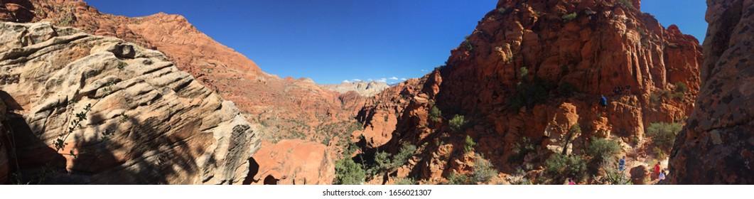 Panoramic of red desert mountians in southern Utah