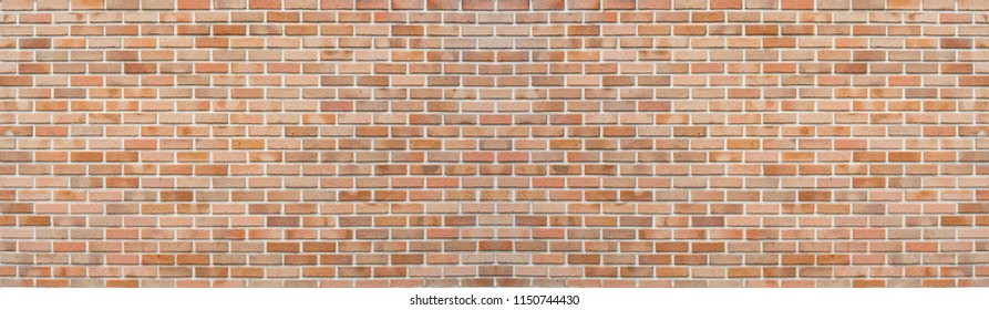 Panoramic red orange old brick wall pattern texture background. Wide panorama of masonry