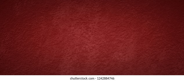 Panoramic red tone wall texture abstract background. Christmas background with copy space and darker vignette.