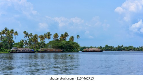 Panoramic river view and traditional house boat in Kerala's Backwaters, India.