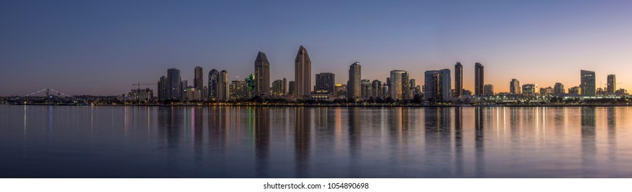 Panoramic San Diego at sunrise with clear sky and reflections on bay