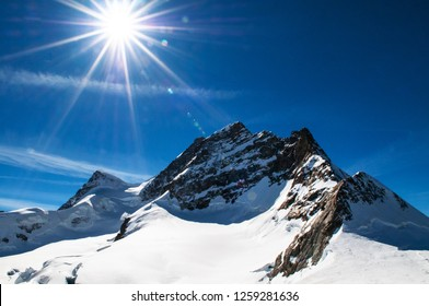 Panoramic scenery of rock cliff Jungfrau peak view from Jungfraujoch, Top of Europe in Switzerland