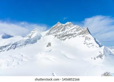 Panoramic scenery of rock cliff Jungfrau peak view from Jungfraujoch, Top of Europe in Switzerland