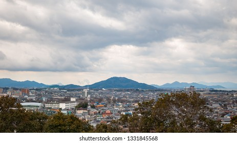 Panoramic, scenic landscape view with beautifully textured clouds that can be seen from Hikone Castle, located in the city of Hikone in Shiga Prefecture, Japan.