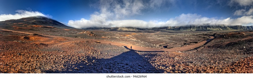 Panoramic scenic view of road on volcanic landscape of the Plaine des Sables, Reunion Island.