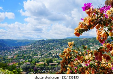 Panoramic scenic view from Saint-Paul de Vence to landscape around with dry flowers of bougainvillea
