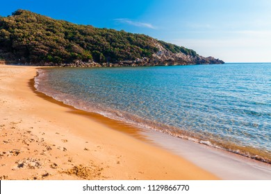 Panoramic sea beach landscape near Gaeta, Lazio, Italy. Nice sand beach and clear blue water. Famous tourist destination in Riviera de Ulisse. Bright sunny light and sunset.