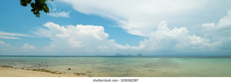 Panoramic sea landscape with clouds on horizon, shot from small tropical island, Thailand.