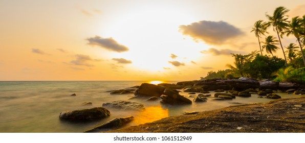 Panoramic sea view of Koh Kood at sunrise with yellow sky with Long Exposure