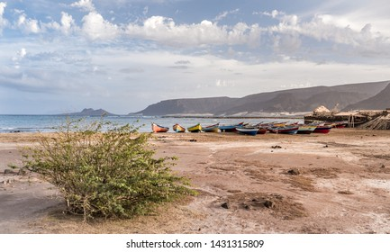 Panoramic seascape of colorful fishing boats, small traditional fisherman's village in Baia das Gatas on the volcanic island of Sao Vicente, Mindelo, Cape Verde. Africa. Traveler outdoor destination.
