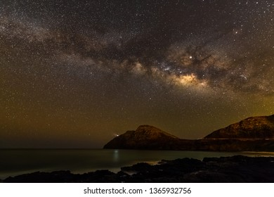 Panoramic seascape of the milky way over the Hawaiian Islands on a warm clear cloudless night - taken from Makapuu beach park in Waimanalo, HI (Oahu)