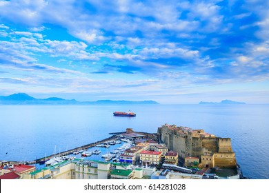Panoramic seascape of Naples, view of the port in the Gulf of Naples, Ovo Castle Castel dell'Ovo, and the island Capri. The province of Campania. Italy.