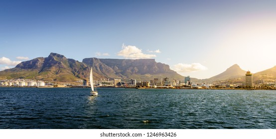 Panoramic seaside view of Cape Town with Table Mountain and Lions Head in the backdrop