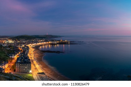 A panoramic shot of the Aberystwyth coast line taken from Constitution Hill during a sunset