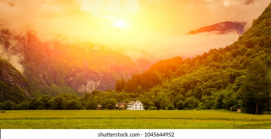 Panoramic Shot Of Beautiful Scene, Sunset Over High Mountain, Summer Landscape In Norway  / Typical Nrowegian Picturesque