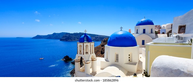 Panoramic shot of the Blue domed church at Oia Santorini Greece Europe