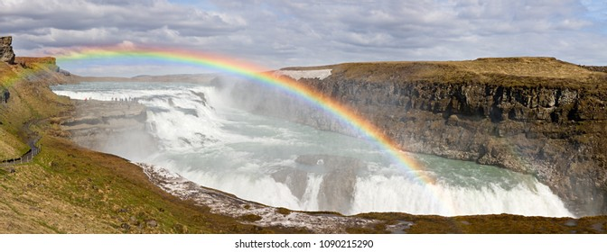 Panoramic shot of the Gullfoss Falls with a beautiful rainbow, Iceland.
