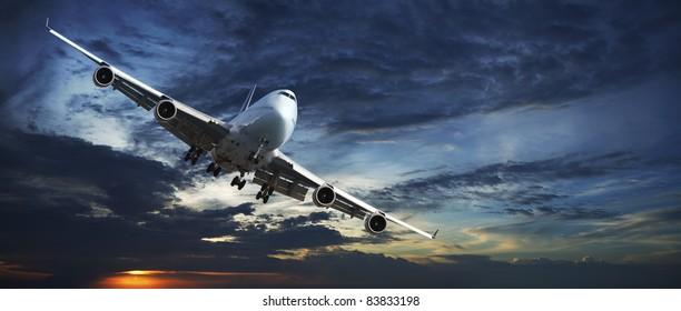 Panoramic shot of a jet aircraft cruising in a sunset sky