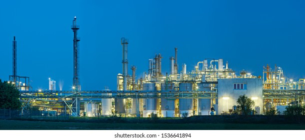 Panoramic shot of a large chemical plant with night blue sky.