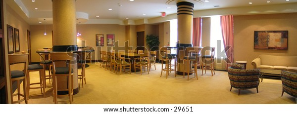 Panoramic shot of a meeting room/banquet area.