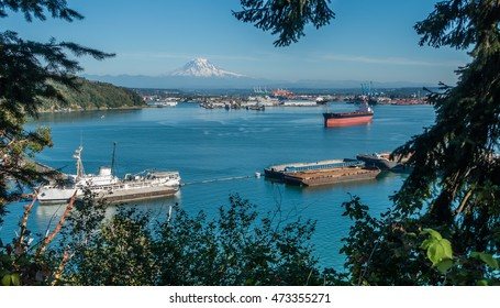 A panoramic shot of the Port of Tacoma with majestic Mount Rainier in the distance.