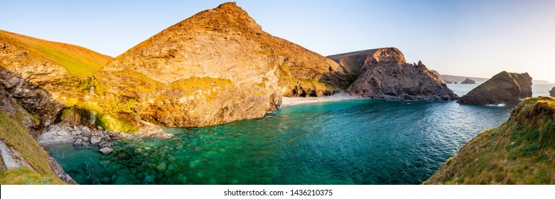 Panoramic shot of Porth-cadjack Cove in sunset light near Portreath on the North Cliffs coast of Cornwall England UK Europe