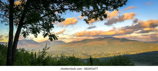 A panoramic shot of the White Mountains in New Hampshire on a summer evening.