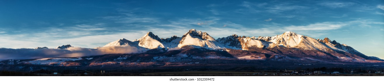 Panoramic shot of winter mountain landscape during sunset. High Tatras, Slovakia, seen from Poprad