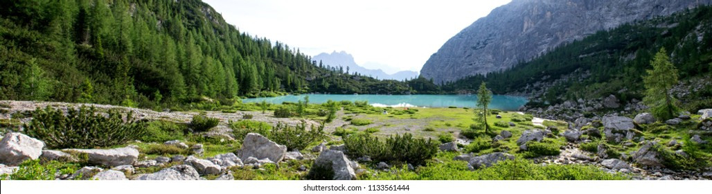 Panoramic shot of the wonderfull Sorapiss lake in the italian Alps, in the Dolomites mountains range close to Cortina in Veneto region, a unique place. The water of the lake is so blue it seems unreal