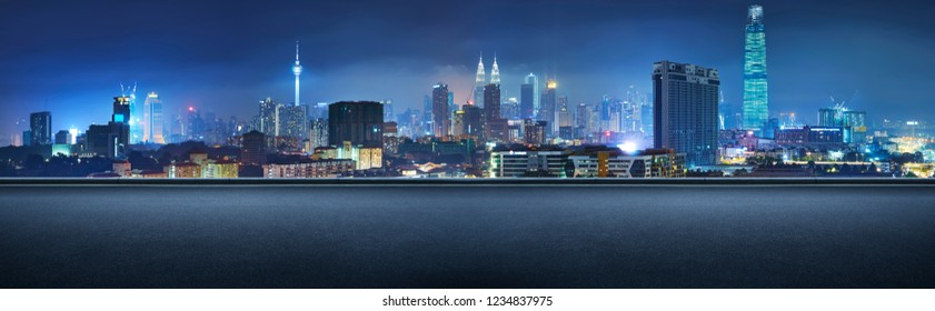 Panoramic side view asphalt road on night , Kuala Lumpur city .