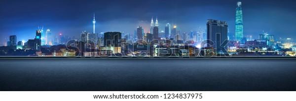 Panoramic side view asphalt road on night , Kuala Lumpur city .