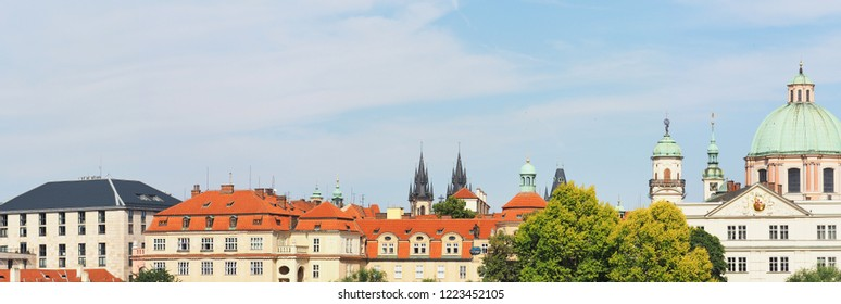 Panoramic sityscape, skyline on a sunny day, roofs of Prague, Czech Republic.Klementinum, Church of Our Lady before Tyn, Church of St. Francis of Assisi