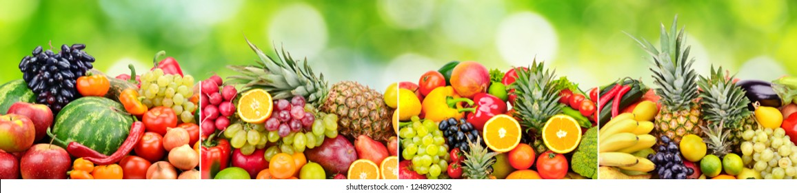 Panoramic skinali from bright fresh vegetables, fruits, berries on green natural blurred background.