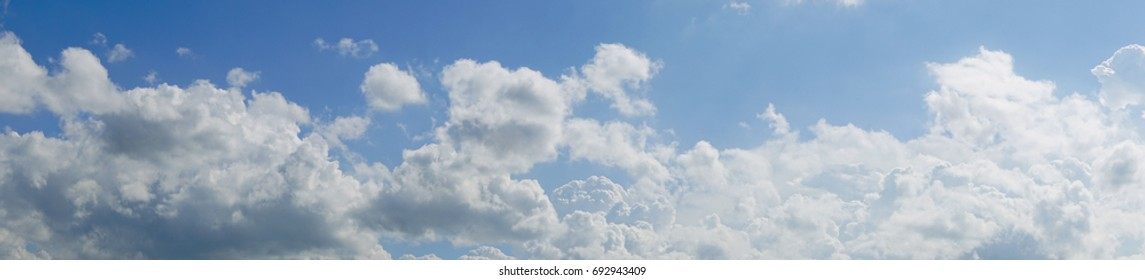 Panoramic Sky - Bright blue in the summer, white clouds covered in long lines, with the sun shining in the daytime.