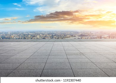 Panoramic skyline and buildings with empty city square floor