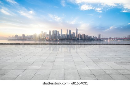 Panoramic skyline and buildings with empty concrete square floor - Shutterstock ID 681654031
