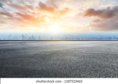 Panoramic skyline and buildings with empty race track road