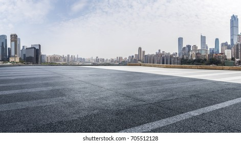 Panoramic skyline and buildings with empty road